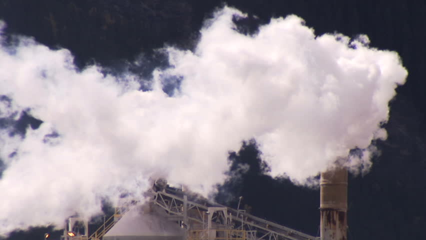 Smoke stacks at cement plant - HD stock footage clip