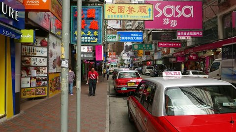 Hong kong - march 31, 2015: old house with many signboards, urban shopping  around causeway bay mtr station  pov camera walk along sideway of lockhart  road at east side, causeway bay, wan chai district