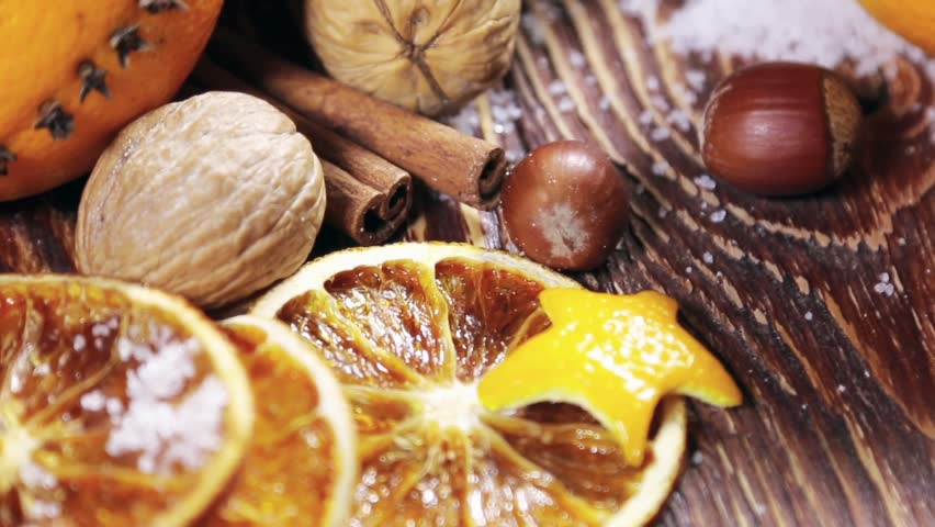 dried orange slices and oranges with cloves