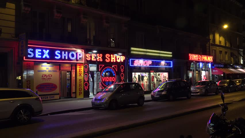 PARIS, FRANCE - AUTUMN, 2015: Sex shop in Paris. Night. France. Shot in 4K (ultra-high definition (UHD)).