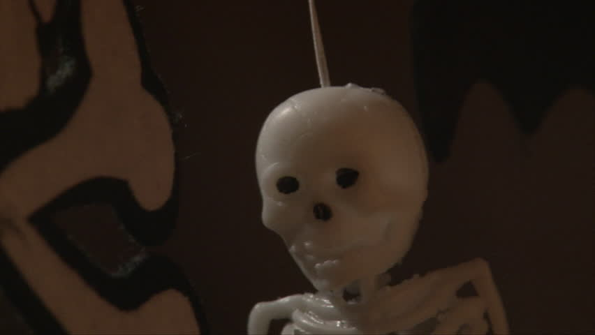 Vertical pan of skeleton hanging on a dark background, Close up for halloween decoration | Shutterstock HD Video #12874598
