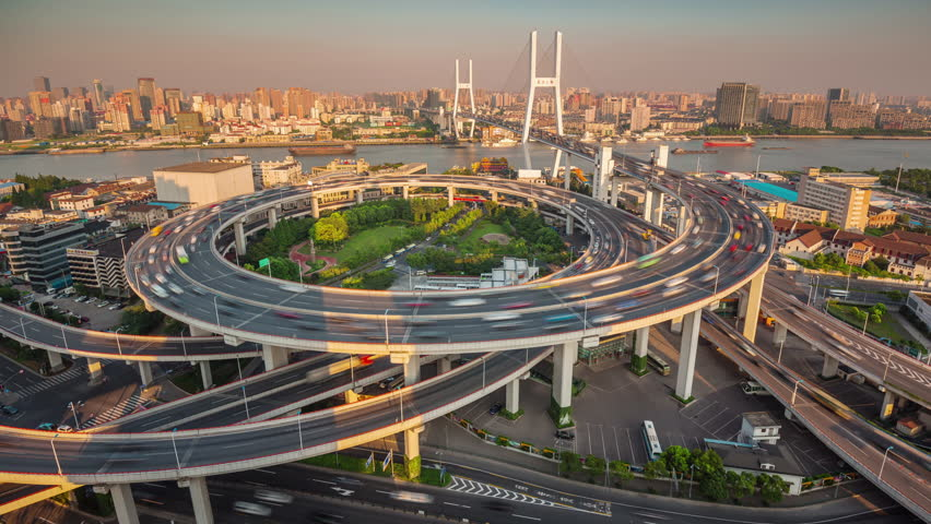 Shanghai sunset traffic road junction bay roof top panorama 4k time lapse china