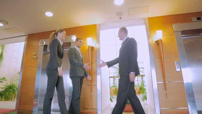 Meeting of business people in the hall Hotels. Partners shake hands, smile and courtesy to communicate. In slow motion | Shutterstock HD Video #12885398