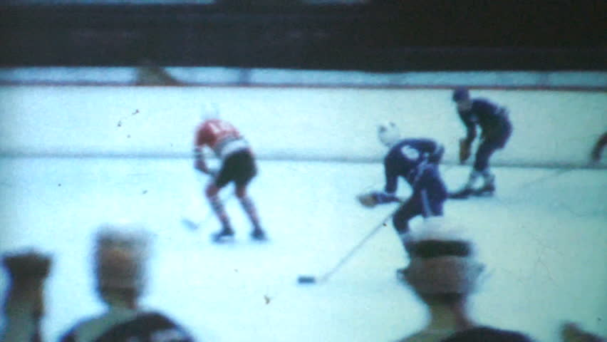 WINNIPEG, MANITOBA, CANADA, JANUARY 1970: A classic clip of an indoor peewee ice hockey game being played during the winter of 1970 in Canada.