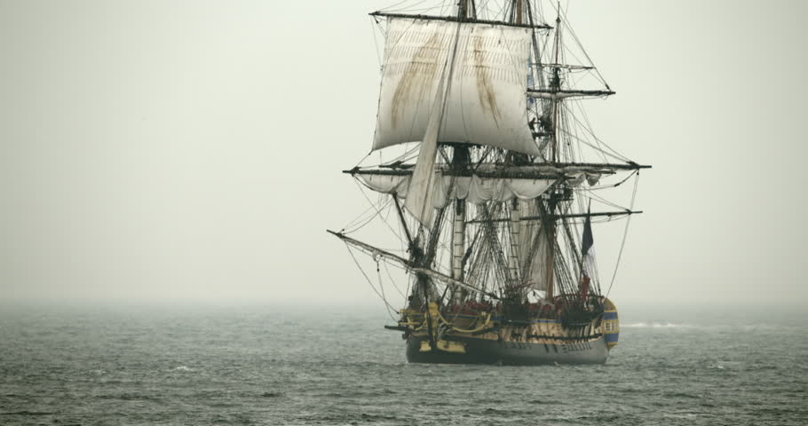 A tall sailing ship schooner sails on the high seas in misty fog. | Shutterstock HD Video #12900878