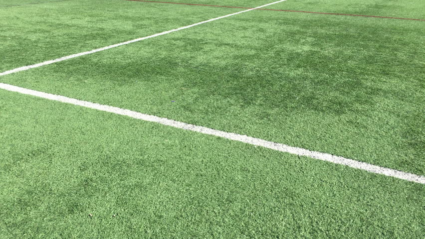 Pan over a green turf sports field #12918338