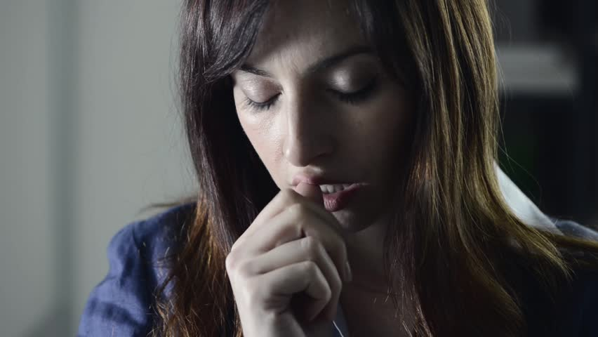Pensive thoughtful young woman touching her lips and chin, she needs to take an hard decision