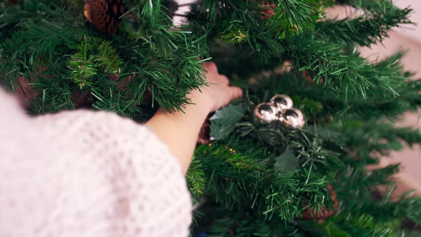 Decorated branch of a christmas tree with light background. 2015 2016 new year. | Shutterstock HD Video #12945392