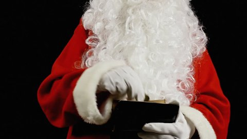 Santa Claus picking out coins from a small purse.