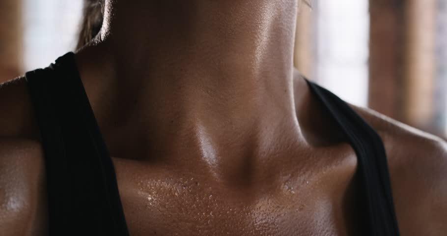 Close up crop of beautiful women fit body fitness studio fierce strength slow motion kickboxer series