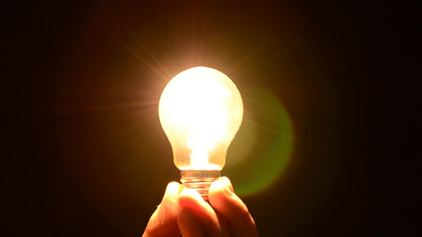 Hand Holding A Light Bulb Stock Footage Video 100 Royalty Free