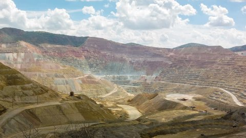 Spectacular panoramic time-lapse of mining trucks in the Chino Santa Rita open cast quarry copper mine, New Mexico, USA