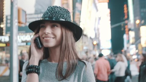Girl is speaking on cell phone
