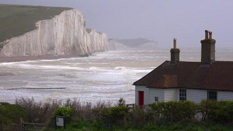 BEACHY HEAD, ENGLAND - CIRCA 2015 - Establishing shot of the beautiful houses along the shore of the White Cliffs of Dover at Beachy Head, England.