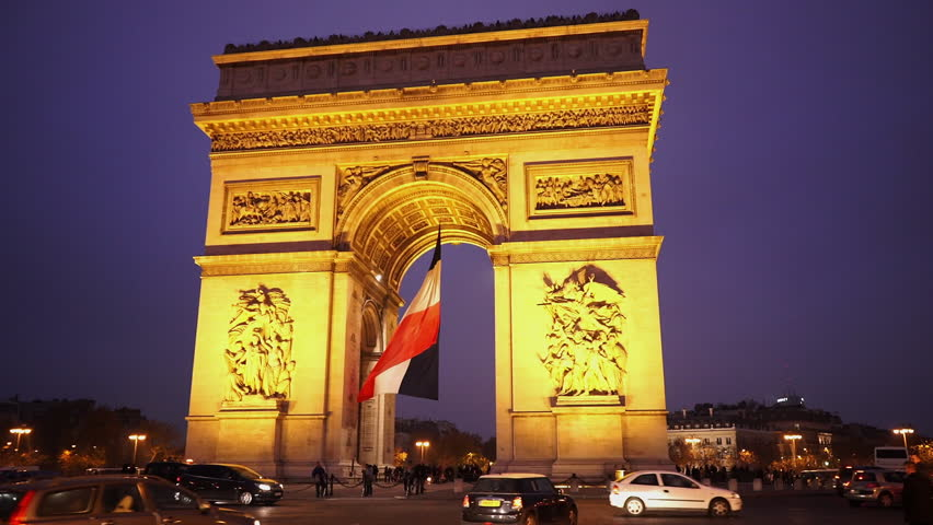 Triumphs arch called Arc de Triomphe with French flag in the evening   Shutterstock HD Video #13119269