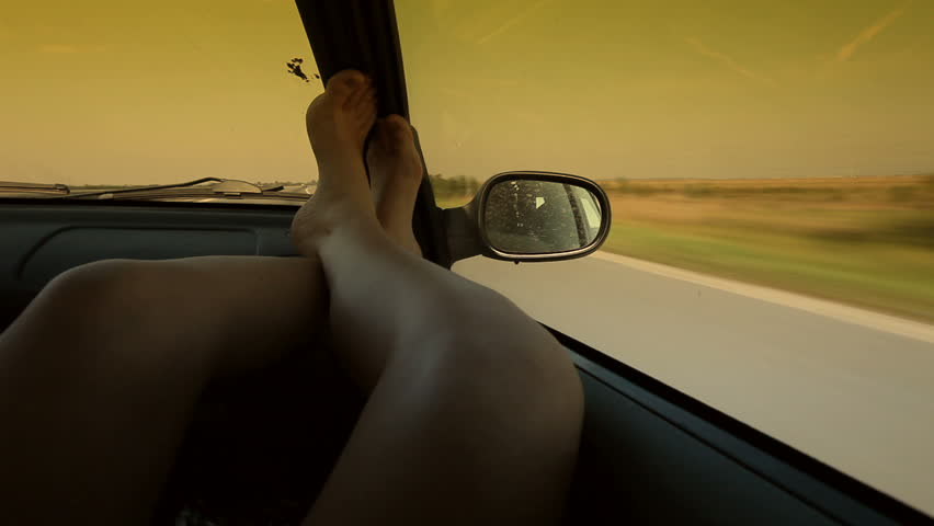 Travel motion background. Putting feet up in car.
