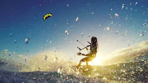 Beautiful Girl Kite Surfing in Bikini. Extreme Kite Boarding in Slow Motion. Summer Fun Action Sports.