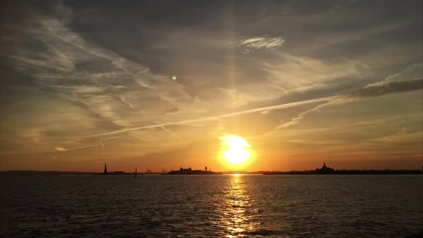 NEW YORK CITY -  Skyline and Hudson river from Battery Park at sunset. | Shutterstock HD Video #13165868