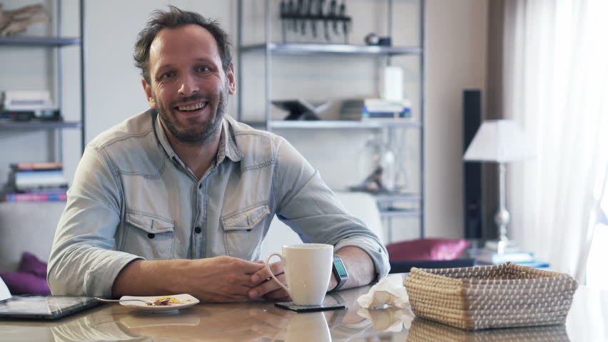 Portrait of happy, young man during breakfast at home   | Shutterstock HD Video #13190828
