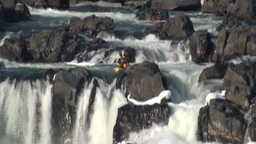 A kayaker plunges off a rapid