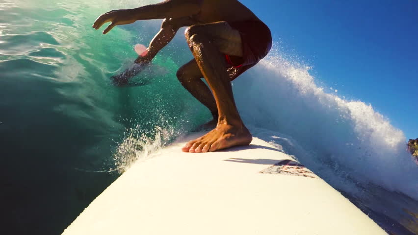 Surfer on Blue Ocean Wave Surfing Getting Barreled. POV GOPRO SELFIE