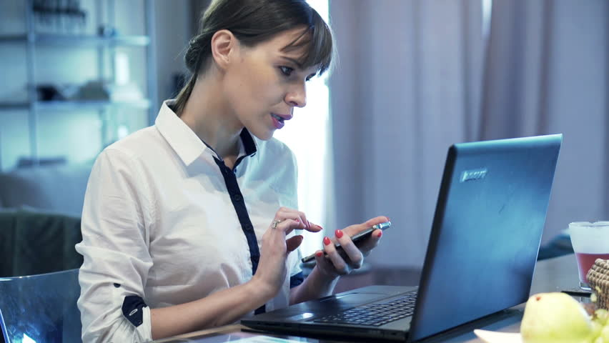 Busy, multitasking businesswoman working by table at home  | Shutterstock HD Video #13207328