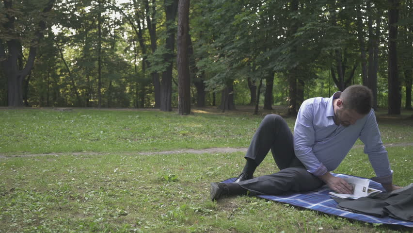 Businessman laying on blanket in park browsing magazine pan shot. - HD stock video & Young Man Doing Push-ups Outdoors For A Workout Or Army Military ...