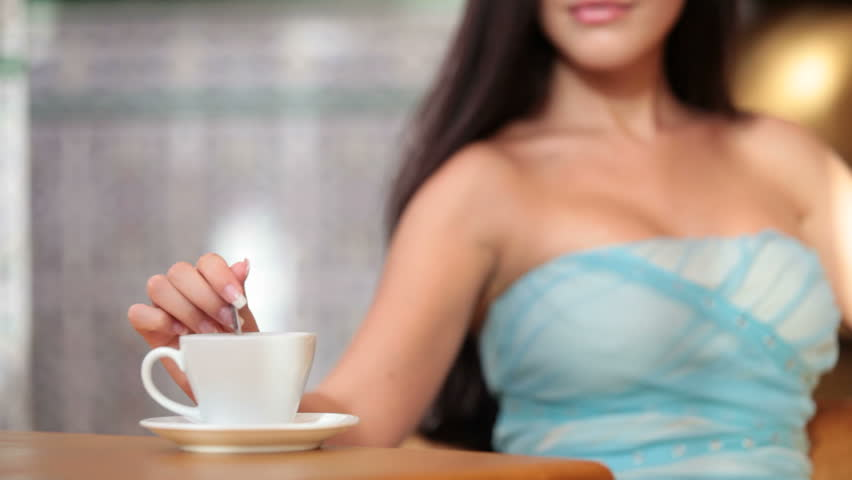woman drinking coffee in coffee shop - HD stock footage clip