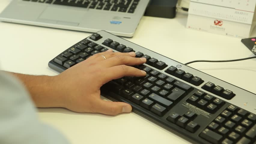 OFFICE INTERIOR - A detailed, close up shot of a man's hands as he types on a computer keyboard. - Santiago, Chile, July, 2014 | Shutterstock HD Video #13243058