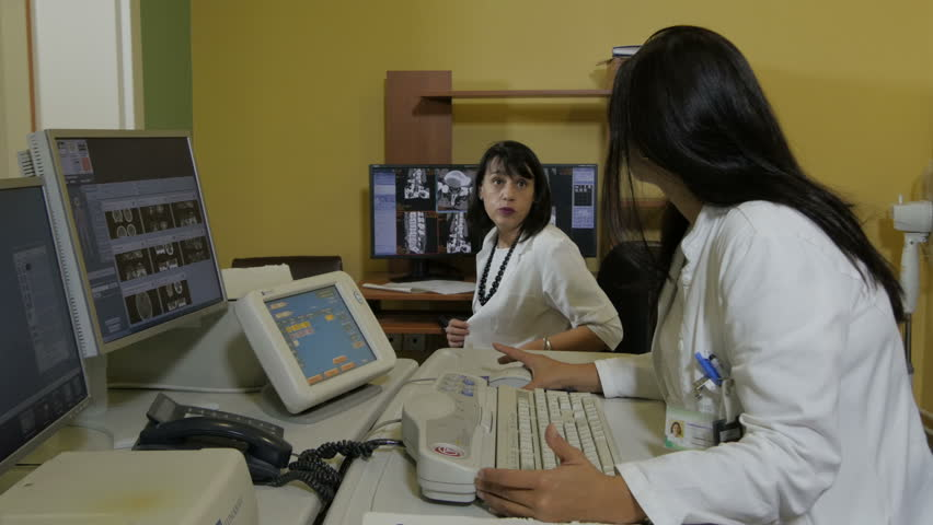radiology technician working with computer, doctor views images, Sphenoid