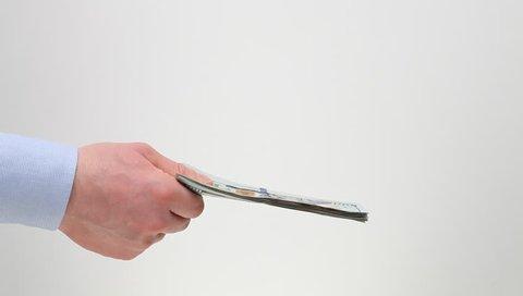 Businessmen's hands exchanging money, closeup shot