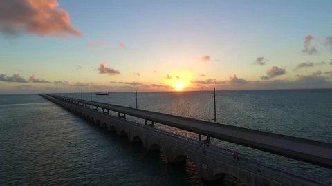 Aerial view of the ocean and Seven Mile Bridge on the Overseas Highway in the Florida Keys at sunrise