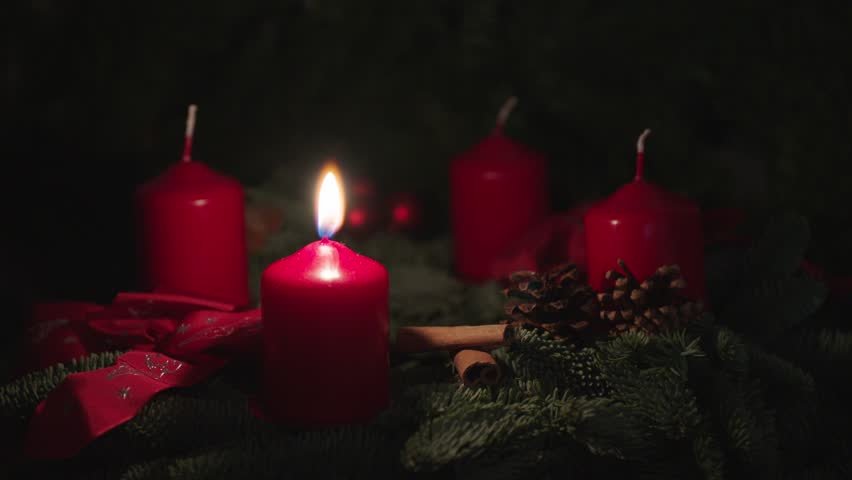 Advent wreath, one candle burning
