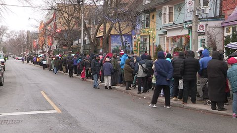 Toronto, Ontario, Canada December 2015 Toronto Honest Ed's store with people lined up for free Christmas turkey