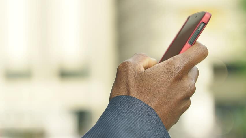 Black american hand using smartphone: closeup footage on black man hand | Shutterstock HD Video #13340765