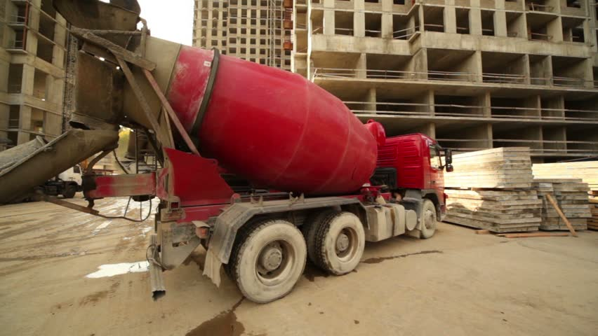Concrete Mixer Stand At Building Place Truck Full Of Sand