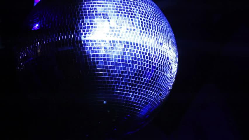 Rotating mirror disco ball in restaurant | Shutterstock HD Video #13390928