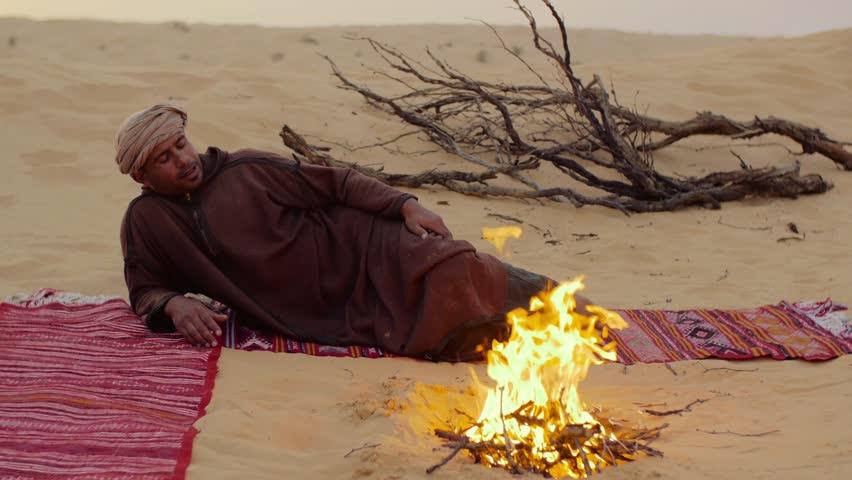 sahara man near a fire