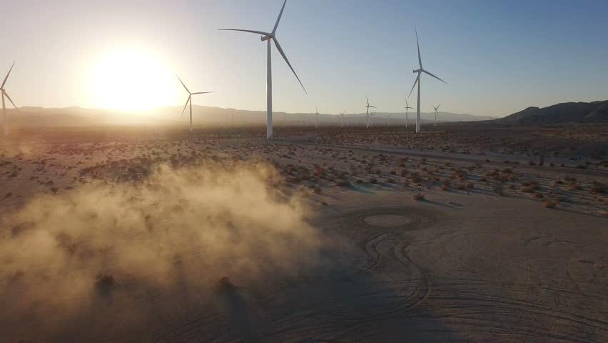4K Aerial flying over wind turbines in desert at sunset #13418708