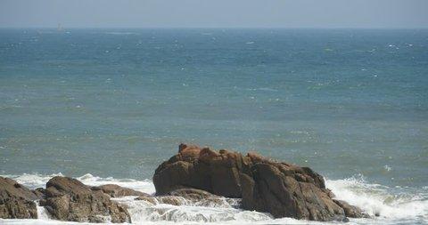4k sparkling ocean sea water waves surface & coastal rock reef coast surge shore. gh2_08466_4k