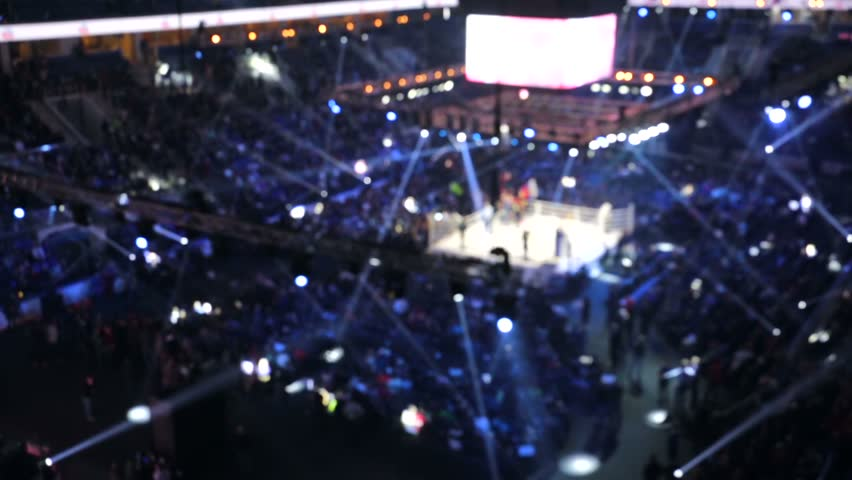 Blurred view of stadium before the show. Abstract performance/sports/concert background with natural lens bokeh.
