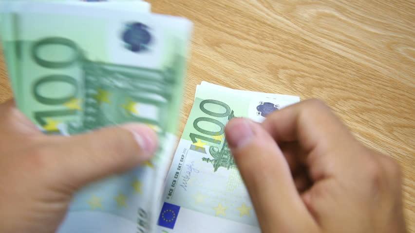 Euro Cash Notes Bills, Wood Table | Shutterstock HD Video #13489748