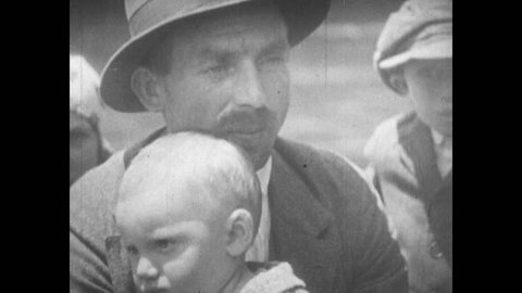 UNITED STATES 1900s: Man Holding Baby, Immigrants Arriving in New York by Boat