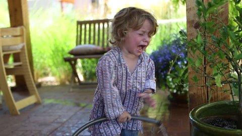 Toddler boy throwing a tantrum outside