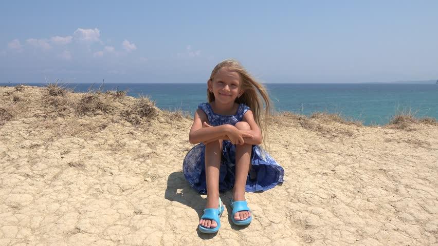 K Portrait Of Happy Little Girl Looking In Camera On Beach Child At Seashore Stock Footage Video  Shutterstock