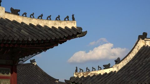 Traditional Korean Japsang Guardian Figures on the roof of pavilions in the Gyeongbokgung Palace. Seoul, South Korea