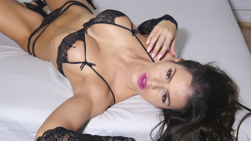 sexy lingerie woman in black lace on bed