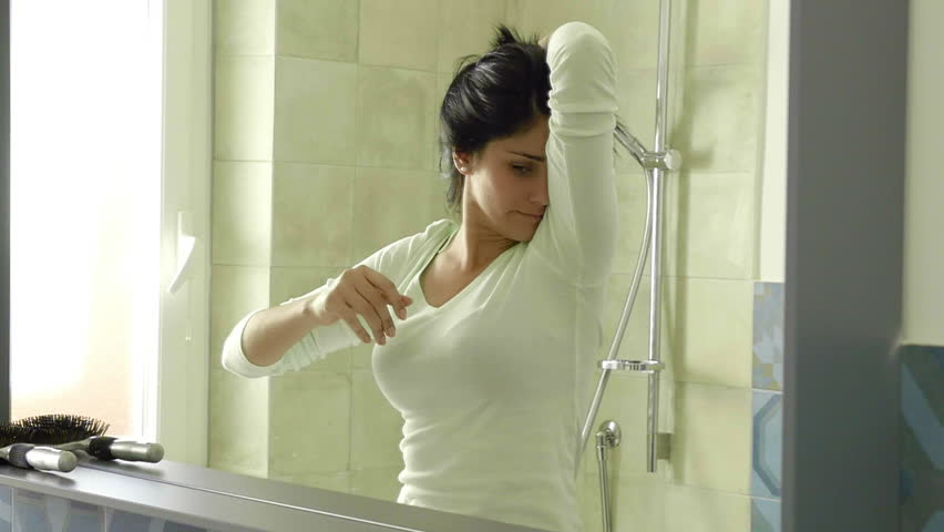 Woman screaming for stinky armpit slow motion in bathroom