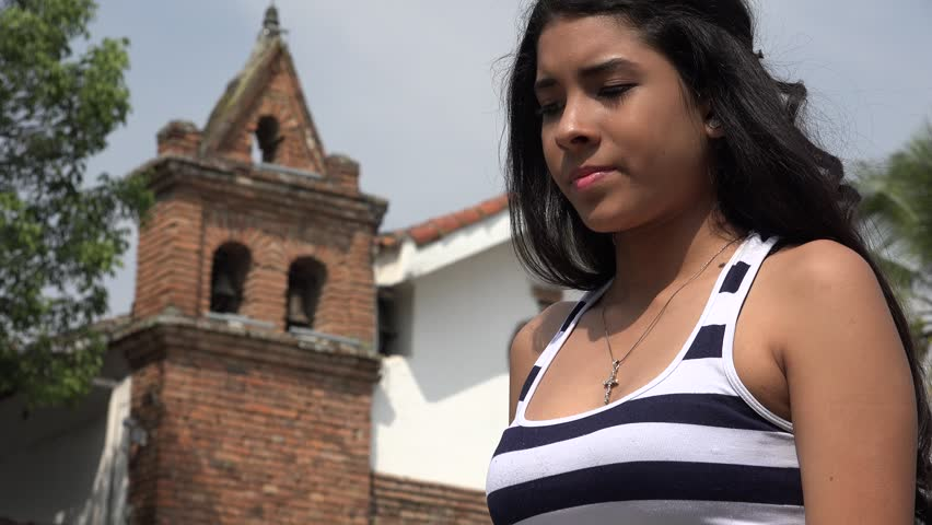 Sad Teen Hispanic Girl at Church