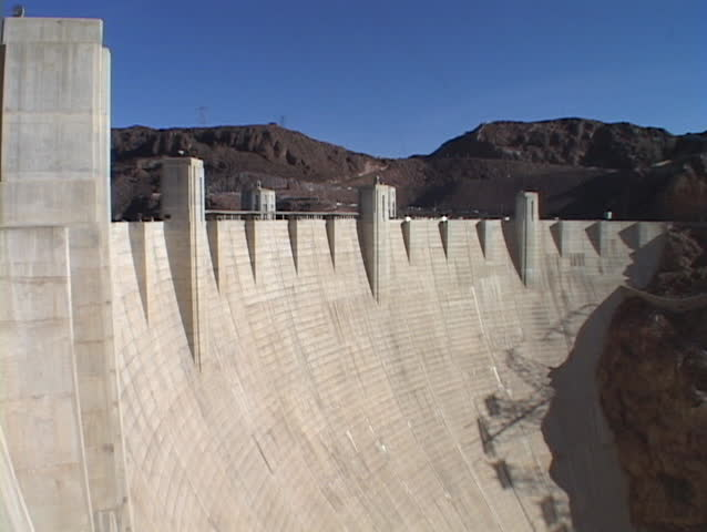 Mountains peak over the majestic Hoover Dam. | Shutterstock HD Video #1377220